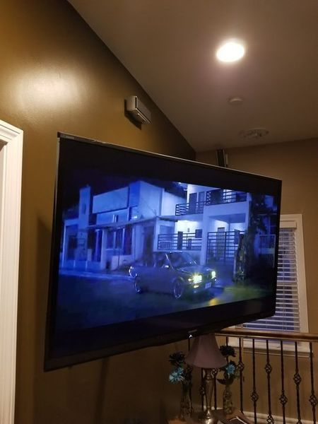 TV installed on a wall in Dighton